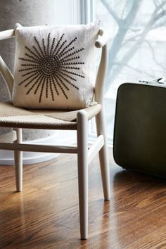 Chair design and pillow fabric flanking foyer side table