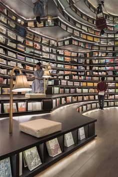 Created by the company XL-MUSE, the bookstore appears to be one endless catacomb, thanks in part to strategically placed mirrors that throw the interior space into an illusion of unlimited rows of books.