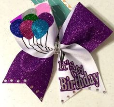 Bows by April - Its My Birthday Cheer Bow Purple Glitter and White Mystique Cheer Bow, $22.00 (http://www.bowsbyapril.com/its-my-birthday-cheer-bow-purple-glitter-and-white-mystique-cheer-bow/)