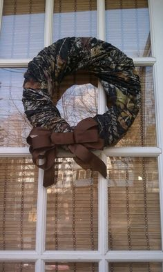 Camo fabric wreath very simple.  hmmm may need this for the door!  orange bow?