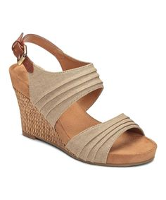A basketweave wedge enhances the look of these sun-ready sandals. Textured straps mean standout styling, and the golden buckles lend understated shine. Aerosoles Core Comfort Technology FeaturesDiamond flex sole absorbs shock and reduces pressureBreathable sueded sock and liningComfort memory foam footbed Product Details 3.75'' heel with 0.75'' platformBuckle closureTextile upperRubber soleImported