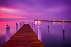 Long exposure at sunset of a pier and the Chesapeake Bay Bridge, seen from Kent Island, Maryland.
