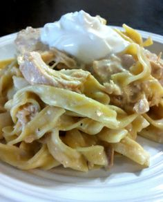 Crockpot Chicken Stroganoff 4 or 5 frozen chicken breasts 1 can cream of mushroom soup 8 oz cream cheese 16 oz sour cream Egg Noodles Salt & pepper to taste