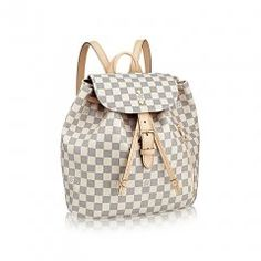 Whether you're a functionalist or a fashion fetishist, the feminine Sperone backpack in Damier Azur canvas is your go-to urban travel companion. It combines a roomy interior with the design details you'd expect from superior Louis Vuitton craftsmanship. Louis Vuitton Purses, Vuitton Bag, Louis Vuitton Monogram, Lv Handbags, Canvas Handbags, Louis Vuitton Collection, Sacs Design, Damier, Prada