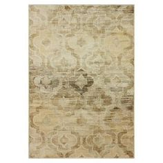 Art silk rug with a weathered quatrefoil motif.  Product: RugConstruction Material: Art silkColor: Beige Note: Please be aware that actual colors may vary from those shown on your screen. Accent rugs may also not show the entire pattern that the corresponding area rugs have.Cleaning and Care: These rugs can be spot treated with a mild detergent and water. Professional cleaning is recommended if necessary.