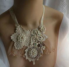This necklace includes vintage trims and fabric as well as crocheted motifs accented with swarovski crystals, glass bead and pearls.
