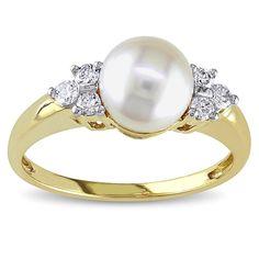 <li><a href='http://www.overstock.com/downloads/pdf/2010_RingSizing.pdf'><span class=links>Click here for Ring Sizing Chart</span></a></li><li>White pearl ring is flanked by diamond trios</li><li>14k yellow gold jewelry</li> <li>Gift box included</li>