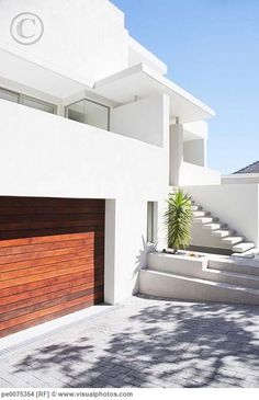 White with wood garage Ultra modern architecture