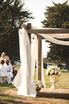 'wood wedding altar with sheer cloth' you like?? i might just use this idea, too...in the WAY future.