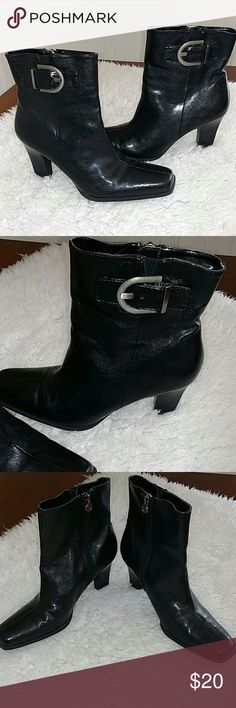 Black boots w/ Buckle Ankle high black Etienne Aigner boots. Zip closure inside ankle and a decorative buckle on outside. Block style heel. Only worn once, maybe twice. No visible scuffs on toes.Faux leather. Cute boots!! Etienne Aigner Shoes Ankle Boots & Booties