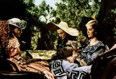 Suellen, Scarlett, and Carreen O'Hara in Gone With the Wind