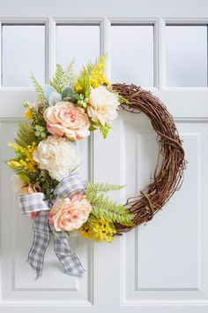 Colorful flowers are a sure sign of spring, and after a dreary winter, we can't wait to decorate in bright florals. We'll show you how to make a farmhouse wreath to dress up your front porch for the season. #diyideas #homedecordiy #diywreath #frontdoordecor #bhg Faux Flowers, Silk Flowers, Colorful Flowers, Large Flowers, Family Wall Decor, Flower Installation, Tulip Wreath, Outdoor Crafts, Wreath Supplies