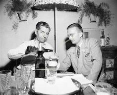 """Charles """"Lucky"""" Luciano, left, former New York vice king, pours a beer during…"""