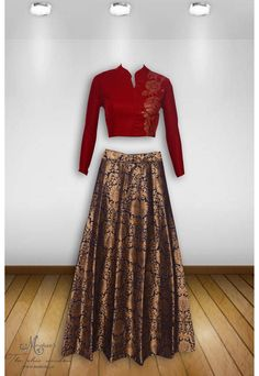 Alluring cherry and blue ensemble with swarovski work on choli and brocade skirt
