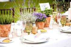 Simple terracotta pots filled with garden plants for a Tuscan Wedding Table…