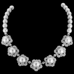 """Platinum flower necklace housing over 12 carats in Collection Quality diamonds and South Sea pearls by Jack Kelége   Established in 1972 and headquartered in Los Angeles, California, Jack Kelége employs the finest jewelers to be found anywhere in the world, all of which he hand-picked and mentored for an average of twenty years. """"All of my artisans have the same strict standards of perfection that I have,"""" Jack Kelége explains. """"I am fortunate to have a staff made up of such remarkable…"""