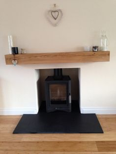 Wood burning stove, oak beam, slate hearth, modern Scandinavian