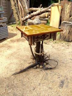 Adirondack style table . Root base rocks antlers twig work birch bark flamed maple top trimmed with mahogany