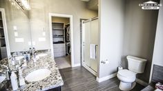 Master ensuite with his and hers vanity, shower with bench, and toilet tucked away in the corner