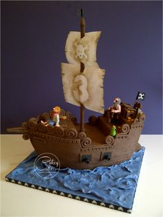 A pirate ship cake made for twin boys birthday. All the details hand painted, the sails are rice paper… So proud of myself for being brave with my airbrush, that thing scares me!Pirate ship - Cake by Sweet Little Treat - CakesDecorA pirate themed b Pirate Boat Cake, Pirate Birthday Cake, Pirate Ship Cakes, 4th Birthday Cakes, Fondant Cakes, Cupcake Cakes, Slab Cake, Party Mottos, Sculpted Cakes