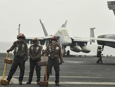 ARABIAN SEA (Aug. 30, 2013) Sailors stand ready for helicopter operations aboard the aircraft carrier USS Nimitz (CVN 68). Nimitz Strike Group is deployed to the U.S. 5th Fleet area of responsibility conducting maritime security operations and theater security cooperation efforts. (U.S. Navy photo by Mass Communication Specialist Seaman Kole E. Carpenter/Released)