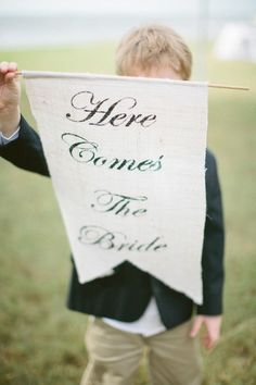 sterling is going to have to do this...no flower girl, just an adorable page boy with a sign. :)