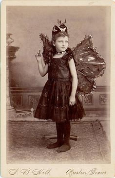 Girl dressed as a butterfly, date unknown.