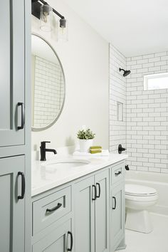 Oil rubbed bronze pulls accent a blue gray bath vanity topped with a white quartz countertop contrasted with an oil rubbed bronze faucet. Bathroom Renos, Bathroom Faucets, Bathroom Ideas, Budget Bathroom, Blue Bathroom Vanity, Bathroom Renovations, Blue Vanity, Remodel Bathroom, Seafoam Bathroom
