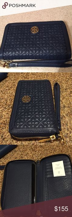 """🆕Tory Burch """"Bryant"""" Smartphone Leather Wristlet. Beautiful Blue (Hudson Bay) stitched leather zip around smart phone wallet/wristlet has the classic double-T logo on the front. Inside has 6 credit card slip pockets, 2 bill/receipt slip pockets and an area for up to an iPhone 6 shown in photo 3. All hardware is in gold and the wristlet strap is removable. New, never used with tag. Approximate measurements: 6.5"""" L x 4.0"""" H x 1.0"""" D. Tory Burch Bags Clutches & Wristlets"""