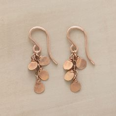"ROSE GLOW EARRINGS -- To create these rose glow gold-dipped earrings, sterling silver paillettes are forged by hand and then dipped in 18kt rose gold, giving them a sunset glow. French wires. Made in USA exclusively for Sundance. 1-1/8""L."