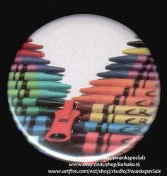 Zipper made of crayons - colorful comment on clothing closures.     Available as a pinback button. We made this with a professional press, using the highest quality materials. It measures 2.25 inches.