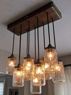 How To Make A Mason Jar Chandelier Primitive Home Decorating Every Dining Room Needs One Of These Diy Rustic Mason Jar Light Hanging Mason Jar Light Out Of Mason Jars Cafe Lights And A Wood… Primitive Home, Mason Jar Lamp, Mason Jar Pendants, Mason Jar Chandelier, Glass Jars, Home Diy, Primitive Home Decorating, Jar Lights, Pendant Chandelier