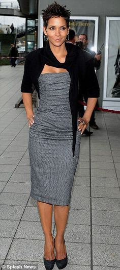 Sleek and chic: Halle wore a tight grey dress and black cardigan as she promoted her new fragrance Reveal in Warsaw, Poland, last week