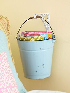 Buckets hung from the wall can hold miscellaneous items, like art supplies or magazines.
