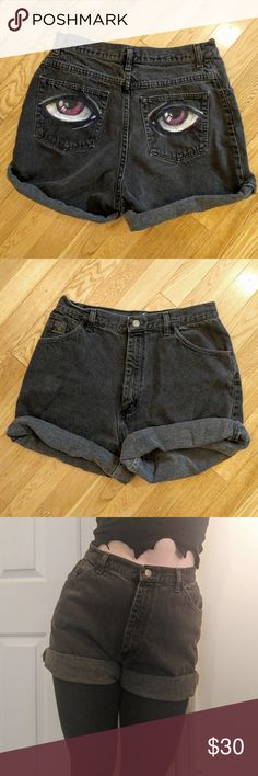 Hand painted High Waisted Wrangler Shorts ?? Very cute Vintage Black Denim high waisted Wrangler for Women Shorts with Hand Painted purple Eyes on back pockets! ?????? There is no size tag but these will fit sizes 8-12 (12 will be snug and 8 will be loose) Wash inside out to prevent wearing off of paint!  Make offers! Wrangler Shorts Jean Shorts