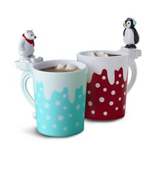 MARSHMALLOW-KICKING MUGS: Turn drinking hot cocoa into an event, Northpole-style. Set your mini marshmallow in the stand in front of the polar bear and press the lever to make him kick the 'mallow into the mug. Cheers!