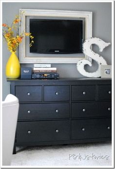 DIY bedroom ideas! They used curved shower rods for curtain rods on each side of a large window. Frame around tv. Made a file cabinet out of a hinged ottoman.... She also put a hinge on a dresser drawer for easy access to the printer And painted curtains!!! Lots of ideas and how to do them, all right here!