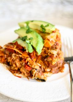 Vegetarian tortilla pie layered with roasted veggies sweet potatoes, refried beans plus the an homemade enchilada sauce. Add chicken for extra protein!