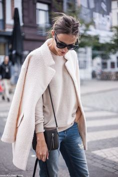 Paulien Riemis is wearing a blush pink fluffy coat from C&A