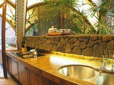 I love the lava rock in this hawaiian bathroom
