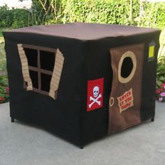 This is a pirate's hideout playhouse that fits over a card table. Other versions are also available, or you can order the pattern and make it yourself.