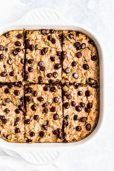 Delicious peanut butter zucchini bread baked oatmeal that tastes like a peanut butter oatmeal cookie! This easy, dairy free zucchini baked oatmeal is packed with protein, freezer-friendly and perfect for making ahead for breakfasts during the week. Serve warm with a dollop of peanut butter on top. #oatmeal #bakedoatmeal #healthybreakfast #brunchrecipe #peanutbutter #zucchinibread