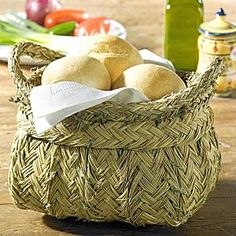 Handmade Esparto grass basket is perfect for serving dinner rolls at the dining room table. LaTienda offers the best of Spain shipped direct to your home - fine foods, wine, ceramics and more. Free catalog.