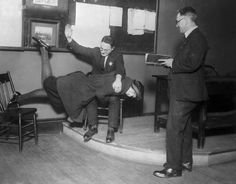 """Corporal punishment for rolled stockings, 1922, Chicago.  Chicago Tribune Archives original caption:  """"Here's what happens when a """"flapper"""" is caught wearing rolled stockings in Chicago. Miss Mildred Richards of Evanston started something when she playfully threw popcorn in a Chicago movie house. She was evicted from the theater, and later brought to court for having created a disturbance. Then it was found she had violated a recent edict warning against rolled stockings. J Chicago Movie, Chicago Chicago, Old Photos, Vintage Photos, Vintage Photographs, Chicago Tribune, Thats The Way, Haunted Places, Interesting History"""