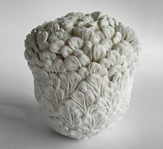 hitomi hosono intricately crafts botanical influenced ceramics