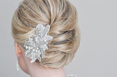 From our friend Kate at The Small Things Blog, a tutorial on the French Twist: very bridal with this pretty hair clip, simply chic without. Click on the photo for the how-tos.