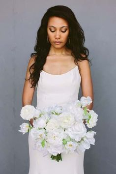 #Sponsored The Audrey Bridal bouquet from Something Borrowed Blooms This bouquet is a free flowing, loosely gathered, hand-tied bouquet made of mixed ivory and white flowers. It features peonies, peony buds, ranunculus, hydrangeas, and beautiful full-blown roses. Premium silk florals. Rent Your Wedding Flowers from Something Borrowed Blooms and save over 70%!