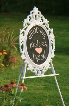 """This was a plain frame w glass.  I took the glass out, sprayed the backing w chalkboard paint & spray painted frame white...the stand is also from a craft store put together and painted.  Super cute entry """"Welcome"""" for guests"""