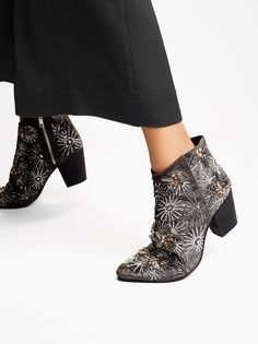 Night Out Ankle Boot | Stunning ankle boot with a western-inspired shape and a lovely velvet design. Features eye-catching embellishments in floral and star shapes throughout. Chunky block heel and pointed toe. Side zipper for an easy on-off.