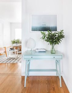 Hallways and console tables are the perfect match. Not only do they treat they brighten up an entryway but they're so handy for keeping keys and change tidy and close to hand as you're on your way out of the house.
